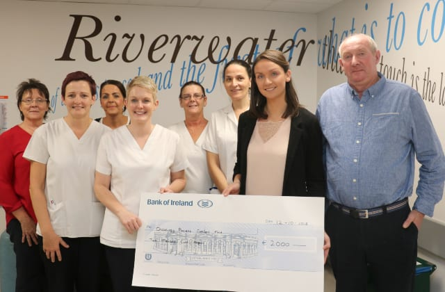 Father and daughter present €2,000 cheque for cancer patient comfort at UHG.